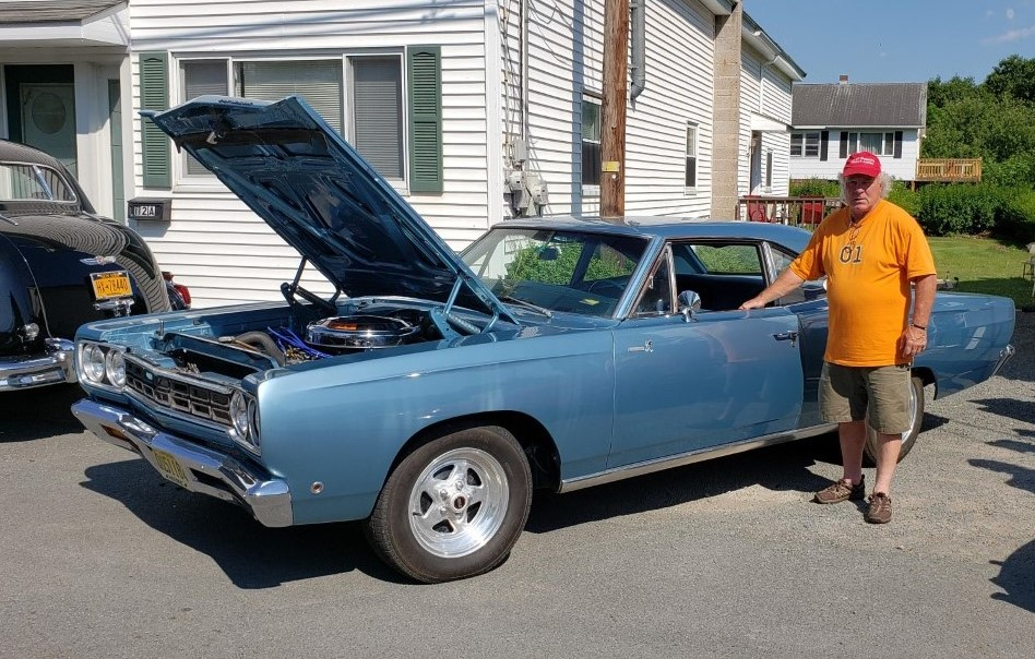 Fred Merusi stands near his B5 blue colored Plymouth Road Runner that he bought from his brother in 1995. Lifestyles photo by Katie Collins.