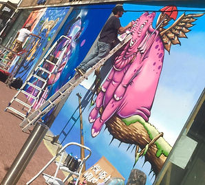 Nik Vaughn aka Mr Frisbee painting @ paint fest.jpg