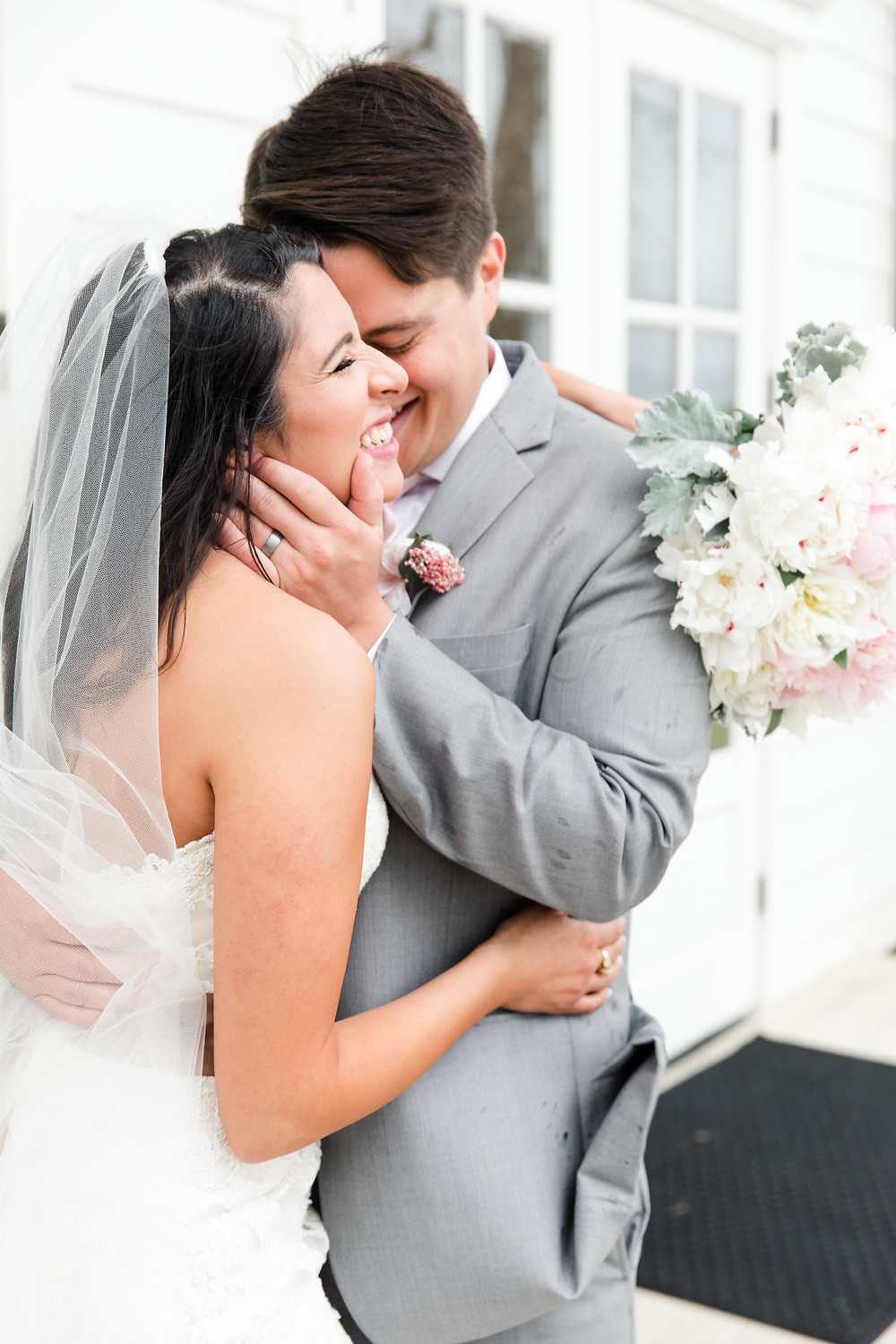 bride and happy groom with white bouquet