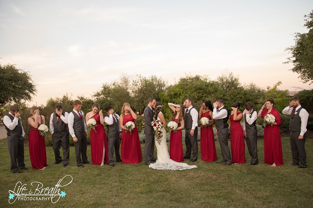 bridesmaids and groomsmen in red