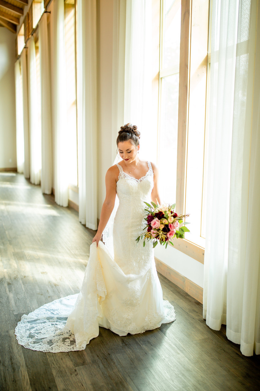 fit and flare lace wedding gown with rose bouquet