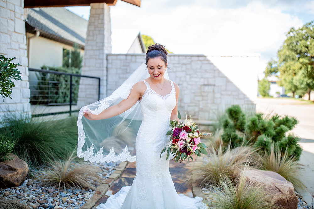 lace v-neck wedding dress with bouquet