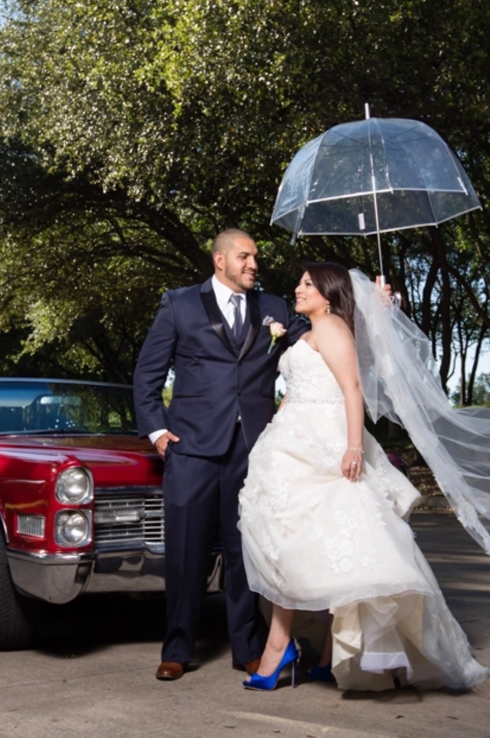 rainy wedding day with bride and groom