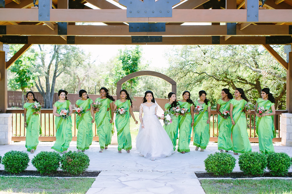 bride and bridesmaids in green
