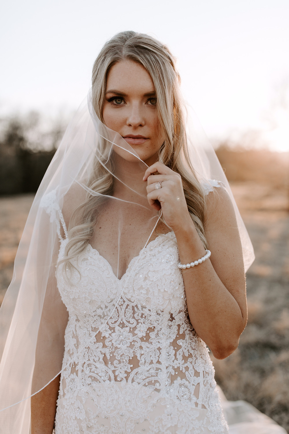 mermaid wedding dress with corded edge veil