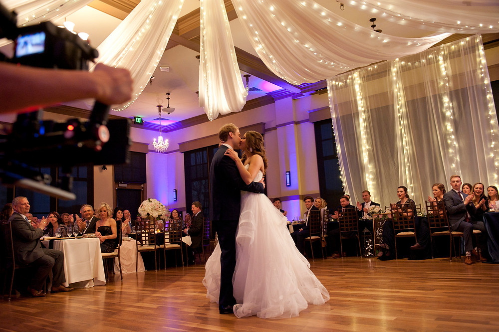 bride and groom first dance in ballgown dress