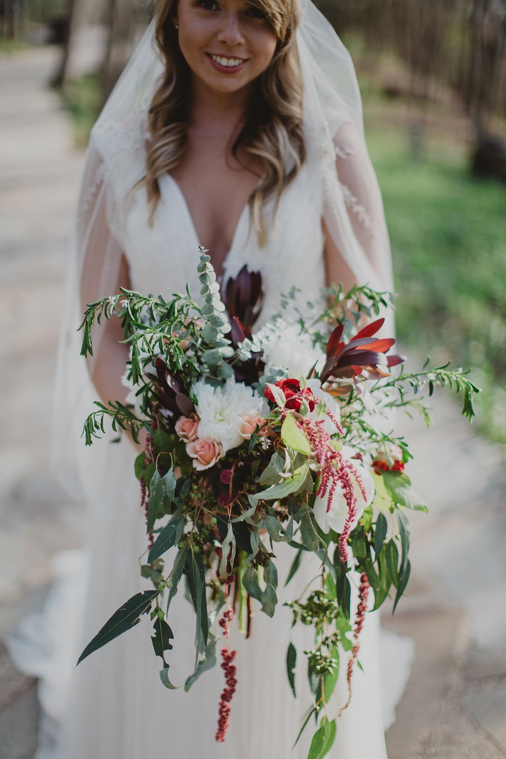 flower and greenery bouquet with bride