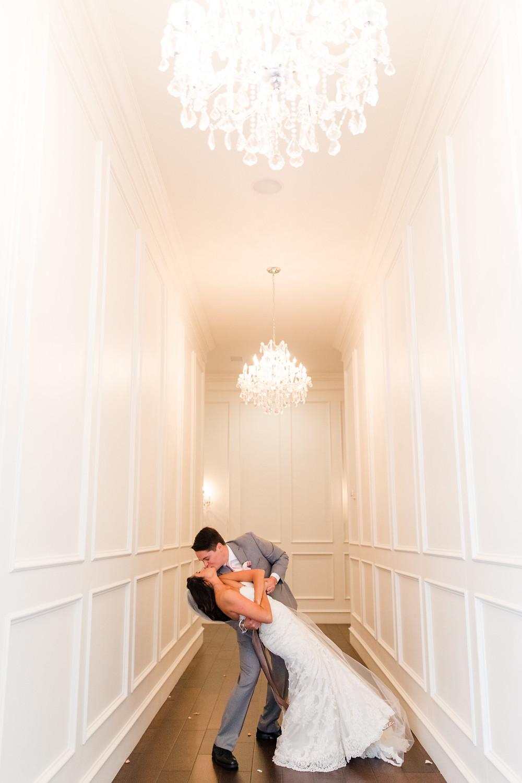 dip wedding dress with groom