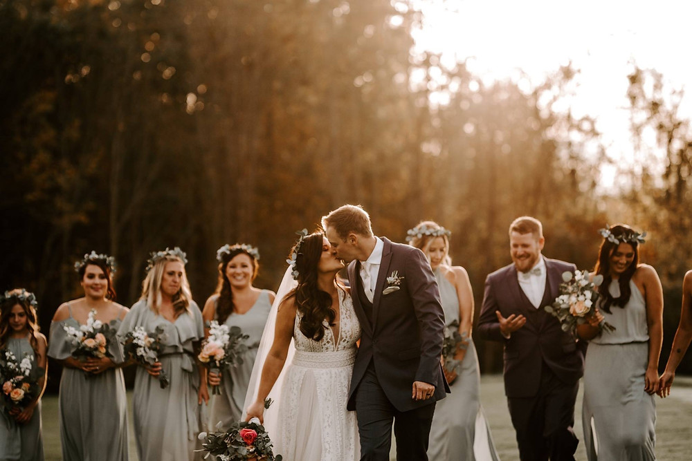 bridal party in light grey with floral crowns