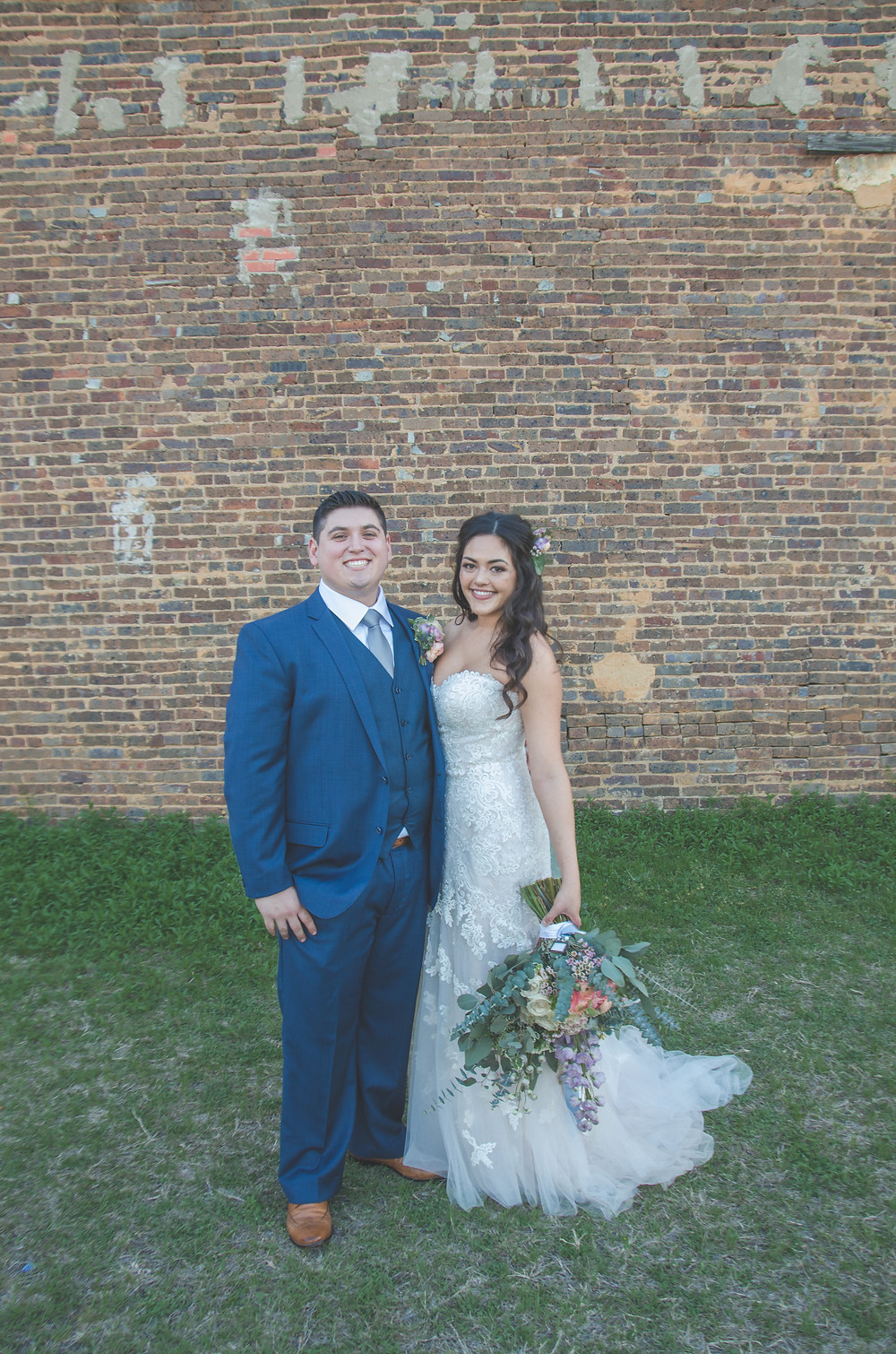 strapless lace wedding dress and blue suit