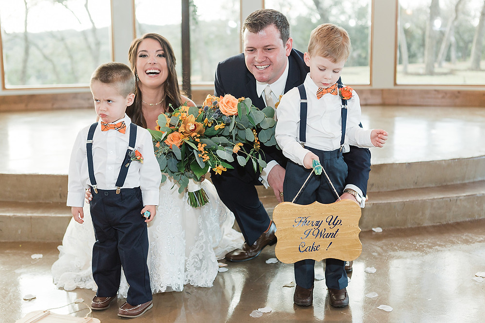 ring-bearers with suspenders and orange bow ties