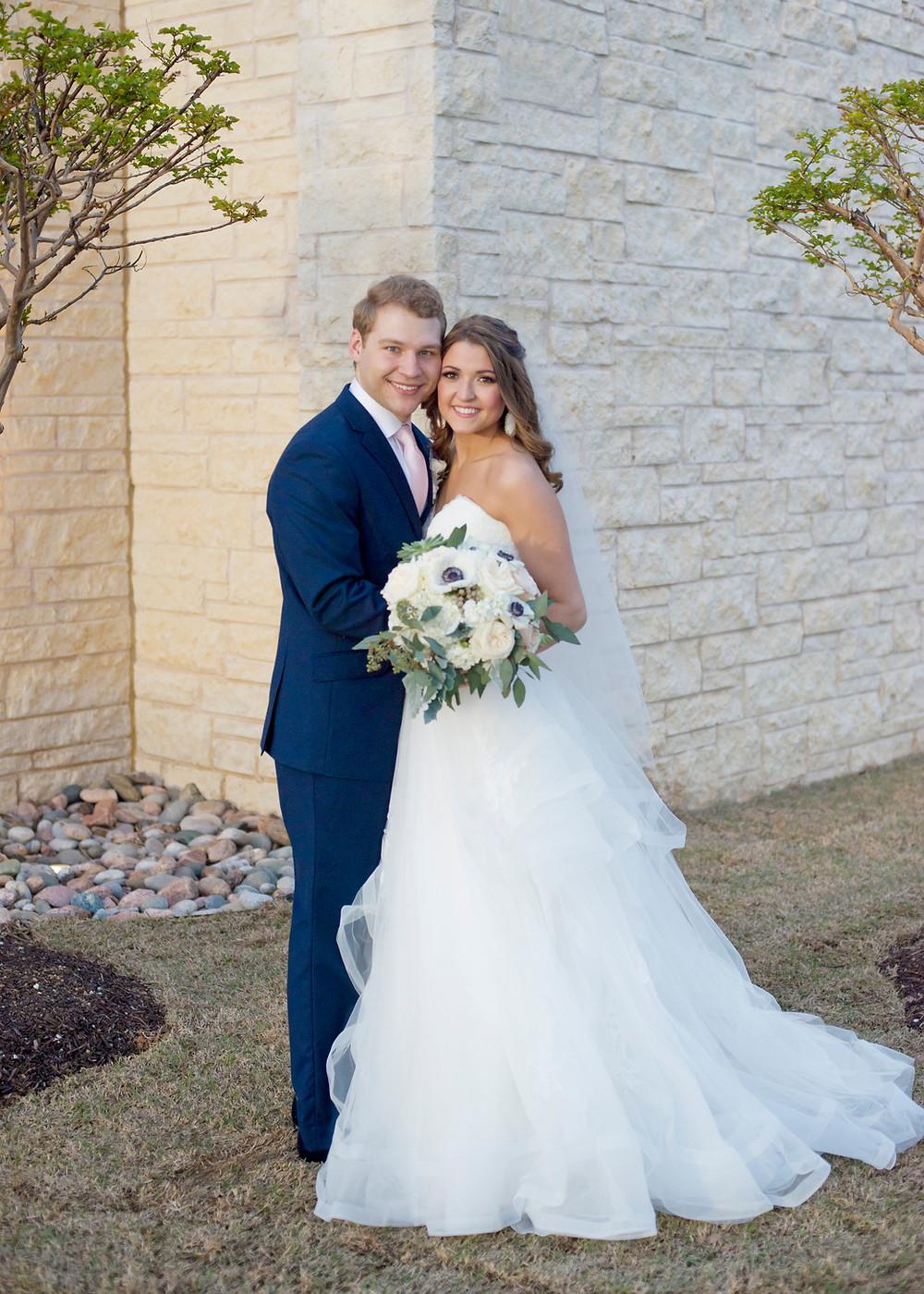 bride and groom in navy suit