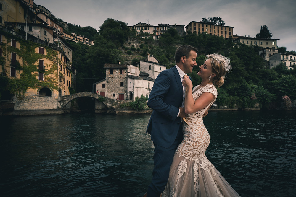 bride and groom in italy with thick lace wedding gowns