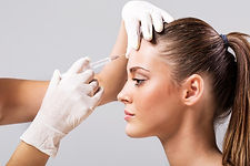 woman-having-botox-injection-on-forehead