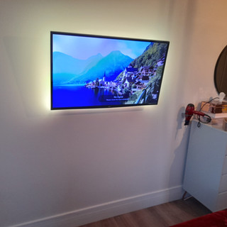 Tv installation in the bedroom with both tv and power point hidden behind the tv