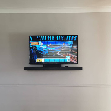 Tv and shelf mounted on the wall for a client from Glasnevin Dublin 9