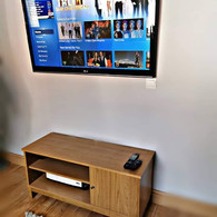 Tv mounted on the wall with tv and power cables concealed