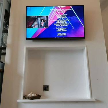 Tv mounted on the flat wall bracket with all cables hidden for a client from Ashbourne in County Meath
