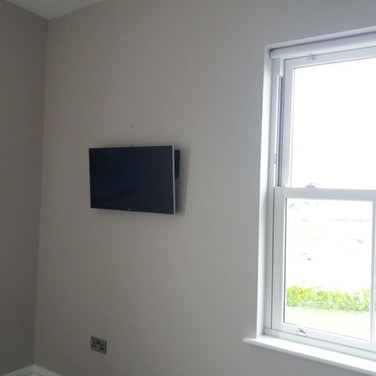 Tv mounted on a flat wall bracket for a client from Curragha Co Meath
