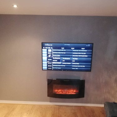 Tv mounted on the wall with cables and Virgin Media box hidden behind the tv for a client from Glandore Road in Dublin 9
