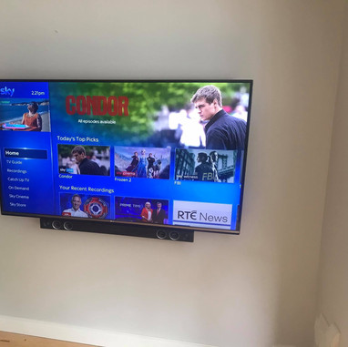 Tv and soundbar mounted on the flat wall bracket for a client from Clonee Co Meath