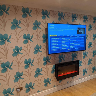 Tv mounted on the swivel wall bracket with a Sky box hidden from the view in Sommerville Kentstown  Co