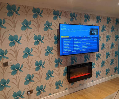 Tv mounted on the wall iwith all cables concealed within walls in Kentstown  Co Meath