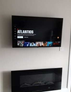 Tv mounted on the wall with all cables concealed  in Blackrock Dundalk Co Louth