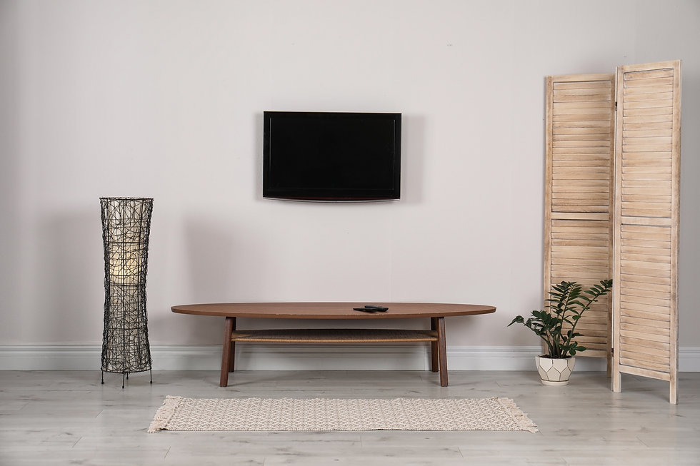 Modern TV set mounted on wall in living