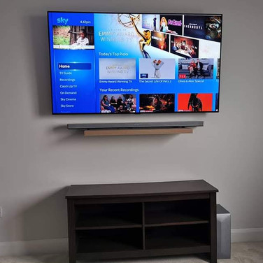 Tv and shellf mounted on the wall for a client from Rathdrum Co Wicklow
