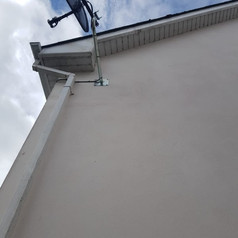 Sky satelite dish installation on the extended arm to avoid satellite signal being blocked by threes