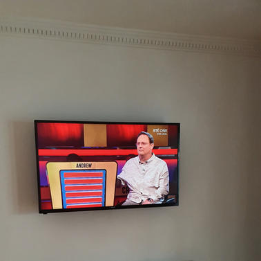 Tv mounted on the flat tv wall bracket in Pinnewood Court Ashbourne