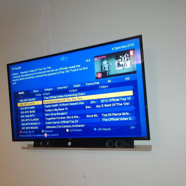 Tv installed on the wall with all cables and Sky box concealed behind the tv in Bray Co Wicklow