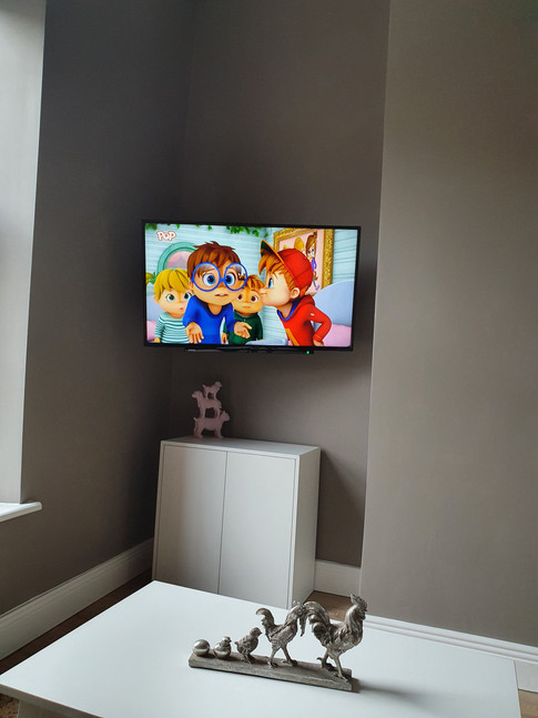 Tv mounted on the wall in the corner, Airbnb apartment in Dublin 1