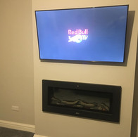 Tv mounted on the tilting wall bracket