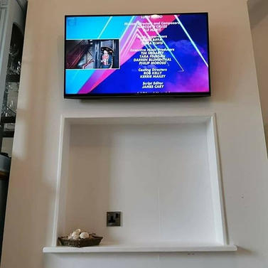 Tv mounted on the wall with cables concealed Hunters Court Ashbourne