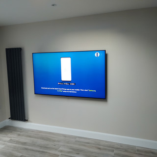 """75 """" tv mounted on the wall in the new home"""
