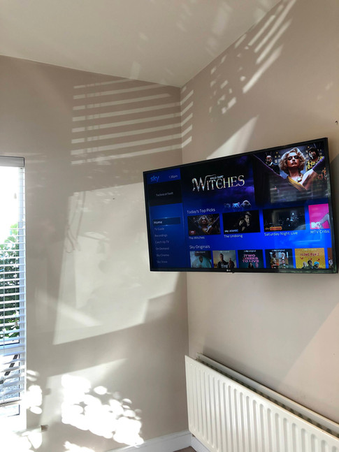 Tv mounted in the corner with a Sky box hidden from the View, Swords, North County Dublin