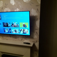Tv wall mounting with both cables and Sky box hidden from the view in Johnstown Navan Co Meath