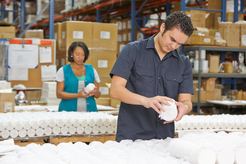 Factory Worker Checking Goods On Product