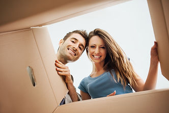 woman and man looking into box.