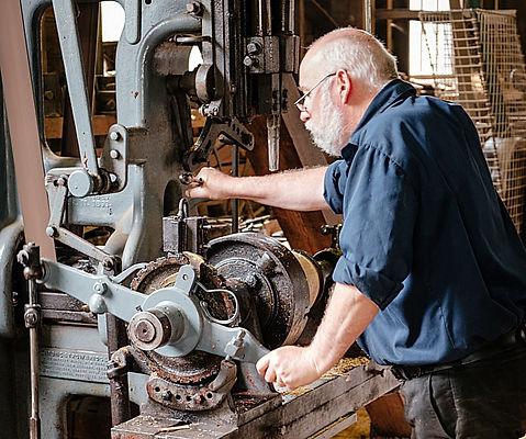 Old Man Operatiing machine - johan-mouch