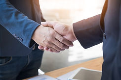 two-confident-business-man-shaking-hands