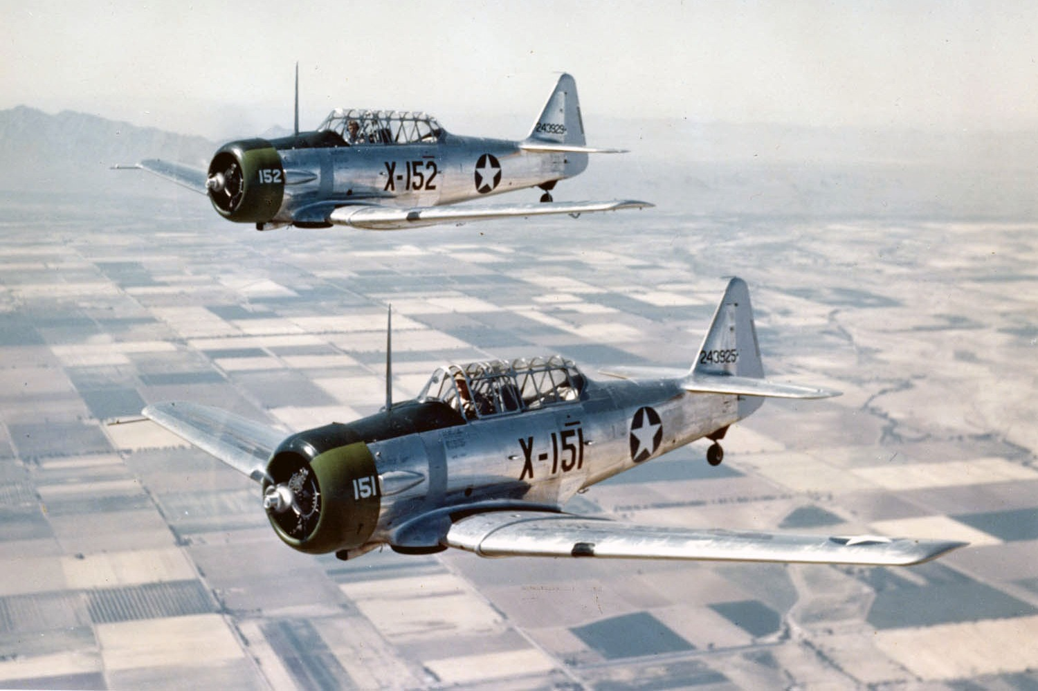 AT-6C_Texans_in_flight_1943_edited.jpg