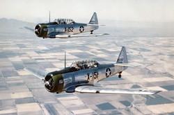 AT-6C_Texans_in_flight_1943_edited.jpg