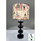 """Stunning custom hand made table lamp designed by Anita from anitadecorate. Bid on this item to be the winner of a lamp specifically designed for a WPPS family.  """"To follow the upcycle theme, I brought back to life a timber table lamp. The base is a high gloss black timber. The lampshade is new and I custom selected the fun vibrant fabric especially for a lucky West Pymble family. """" The lamp is 81cm."""