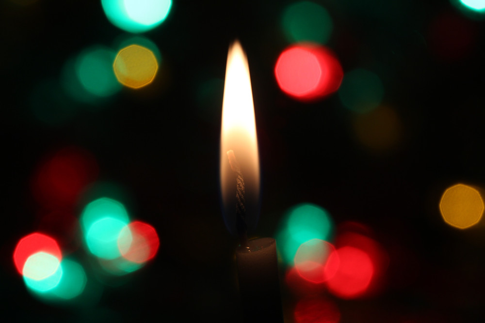 Lit Candles with red and green background lights