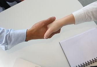 Handshake nach Vertragsabschluss