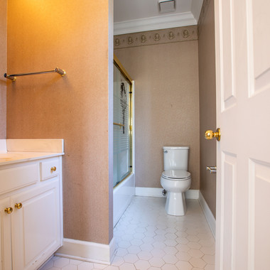 Main Level Full Bath in Front BR.jpeg