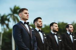 Grooms men wearing navy tuxedos